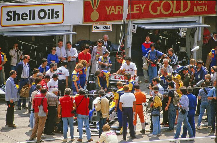 Nelson Piquet's Williams surrounded by photographers at the British Grand Prix