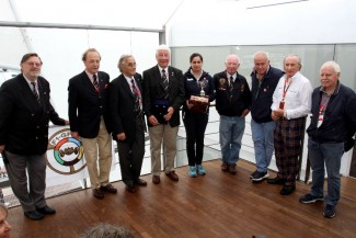 Monisha Kaltenborn receives the Jean Sage Memorial Award from President Howden Ganley and joined by,left to right, General Secretary Theo Huschek ,Antoine Seyler, Nannni Galli, Howden, Monisha, Teddy Pilette, Patrick Tambay, Sir Jackie Stewart and Jos Vonlanthen.(Photo Axel Schmidt)