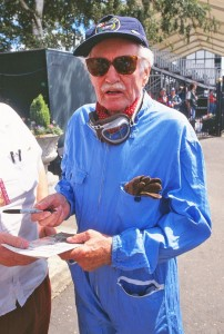 De Graffenried signs autographs at a historic event which gave him the change to get back into racing overalls.