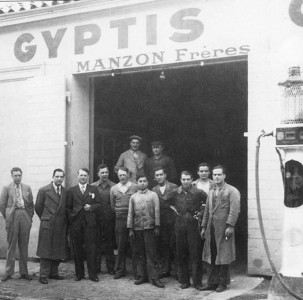 Robert, third from the right, outside the family garage in the 1940s