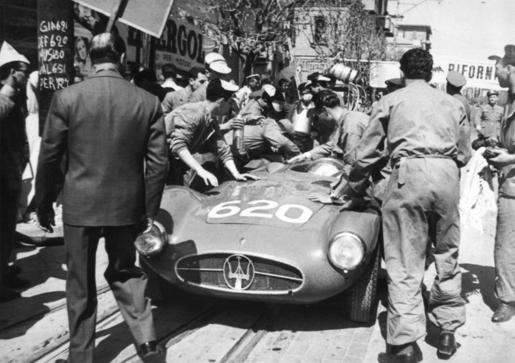 An interesting photo of Maria-Teresa with her Maserati A6GCS on the 1955 Mille Miglia. Note the board on the left listing the names and numbers of the Maserati drivers with MT and race number 620