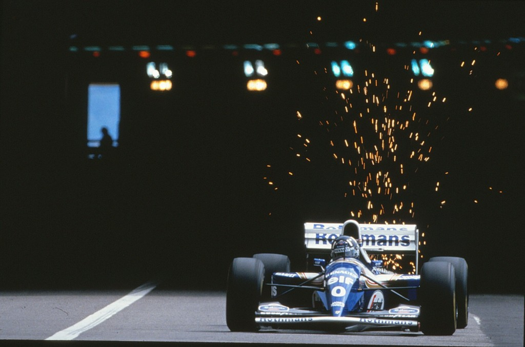 Damon Hill kicking up the sparks leaving the tunnel at Monaco with the Williams