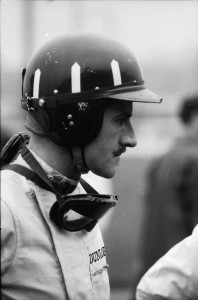 Graham Hill with his familiar London Rowing Club helmet