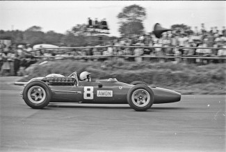 Chris Amon in action at Silverstone in the Ferrari 312 63/V12 in the British Grand Prix of 1967. He finished 3rd that year.