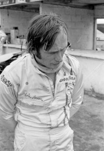 Chris Amon reflects in the Paddock.