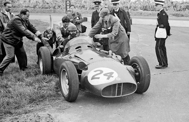 Tony Brooks in the BRM P26 gets a push start from driver Mike Anthony at the 1956 British Grand Prix when his throttle cable broke