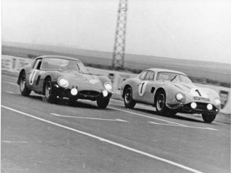 Claude in Aston Matrin DB4 Zagato (1) just beats the Ferrari 250 GTO of Sylvain Garant at Reims during a race on the Route du Nord event in 1964.
