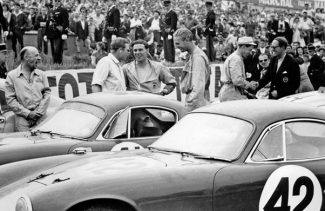 Whitmore, center right with Jim Clark on the grid for the 1959 Le Mans 24 Hours with the Border Reivers' Lotus Elite.