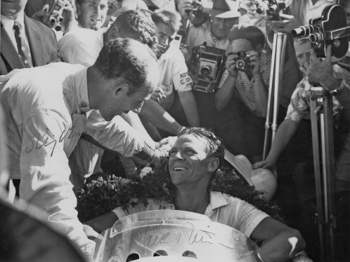Paul Frere being congratulated by Stirling Moss for winning the non-Champinship South African Grand Prix in 1960 with a Cooper-Climax. Stirling finished second (Photo Rob Young Archive)