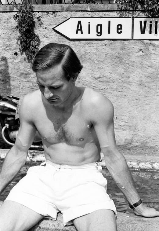 Sixty five years ago, Innes sitting on the edge of the fountain at the Swiss village of Ollon waiting to run his Lotus Eleven