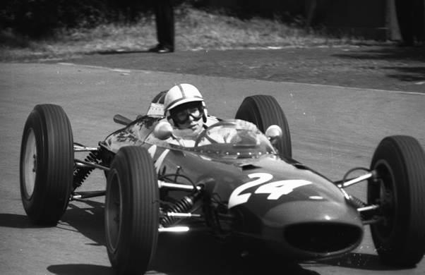 John Surtees at the wheel of the Bowmaker Lola T4 at Aintree 1962