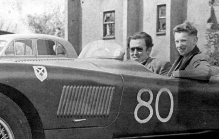 Sir James Scott Douglas, left, with his C type Jaguar and a youthful Graham Gauld photographed at Castle Combe circuit in 1953