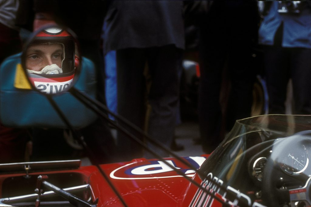 Niki Lauda in the mirror of his March-Ford before the 1972 Monaco Grand Prix. Photo: Grand Prix Photo