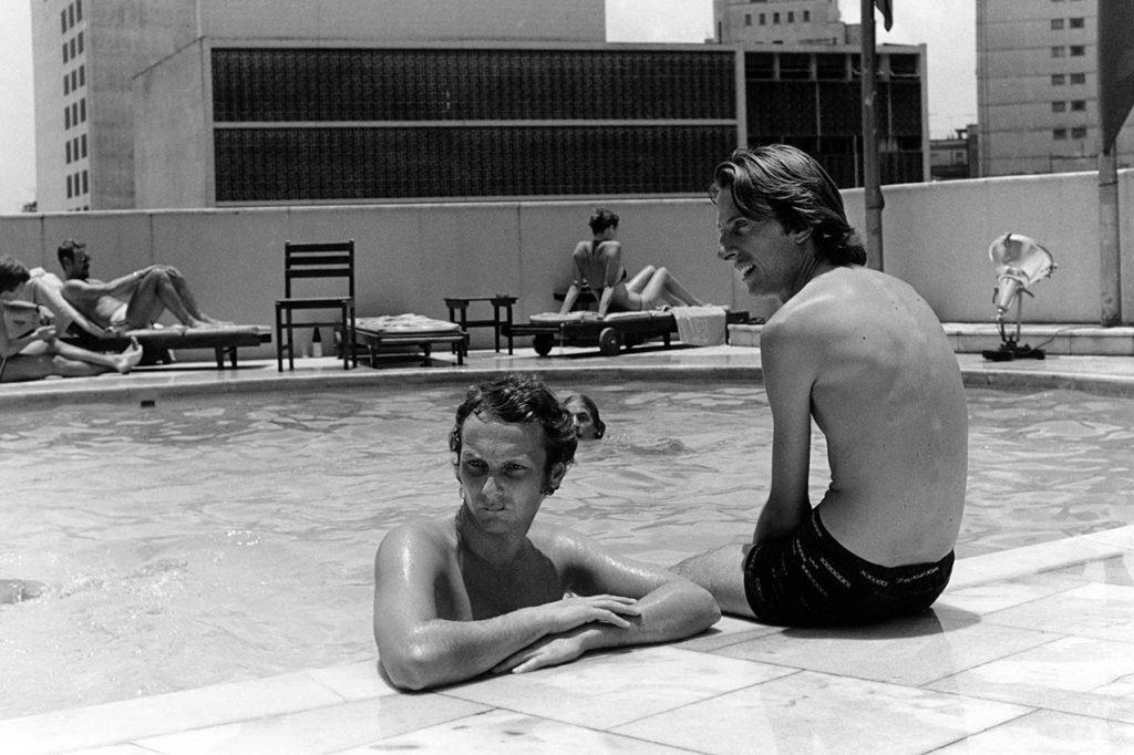 Ferrari driver Niki Lauda and team principal Luca de Montezemolo at the pool of the Sao Paolo Hilton, 1976. Photo: Grand Prix Photo