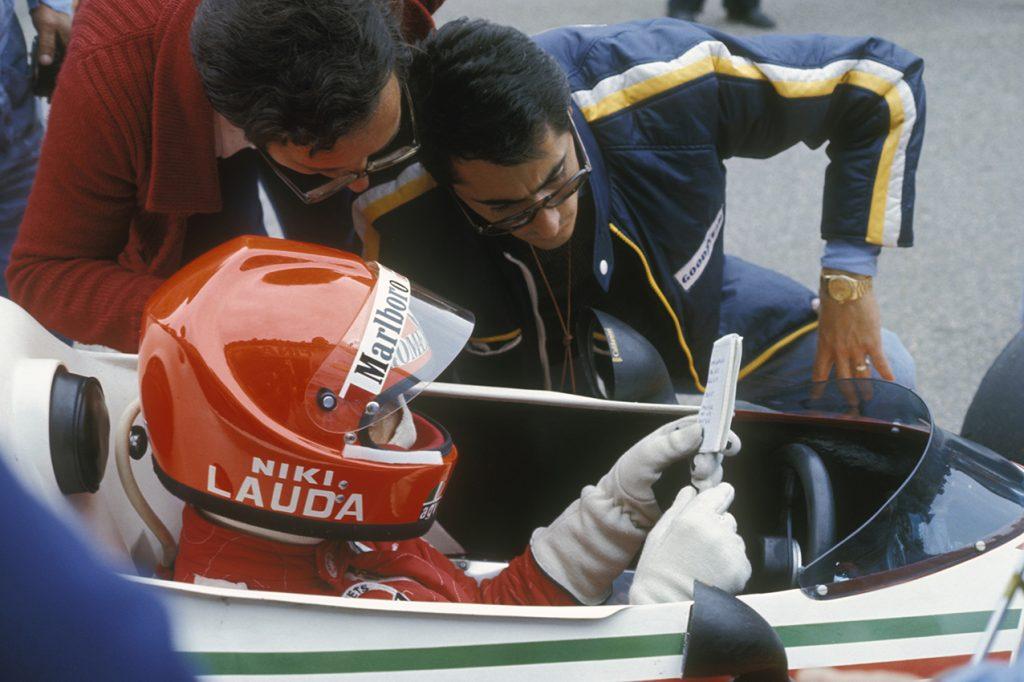 Niki Lauda with Ferrari technical director Mauro Forghieri and team manager Daniele Audetto during practice for ithe 1976 Italian Grand Prix at Monza. Photo: Grand Prix Photo