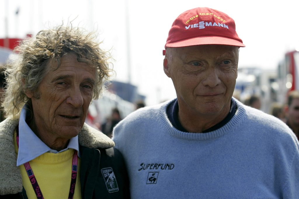 Niki Lauda meeting his rescuer from his accident in 1976 Arturo Merzario after qualifying for the 2006 European Grand Prix at the Nurburgring. Photo: Grand Prix Photo