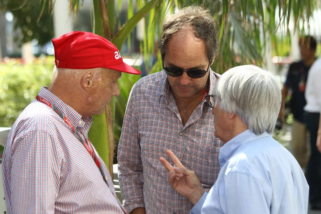 Niki Lauda, Gerhard Berger and Bernie Ecclestone before the 2011 Abu Dhabi Grand Prix at the Yas Marina Circuit. Photo: Grand Prix Photo
