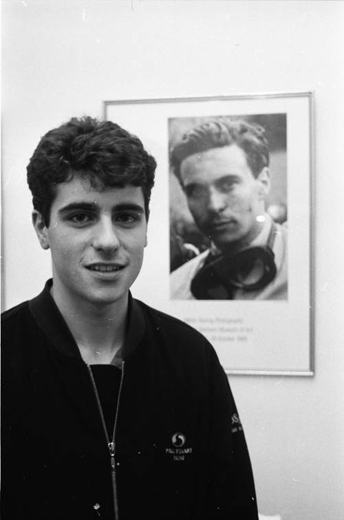 Black and white photo of a young man called Dario Franchitti in front of a photo os Formula 1 racing legend Jim Clark