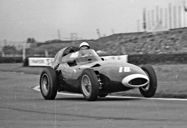 Stirling Moss in typical action at the 1957 British Grand Prix in the Vanwall