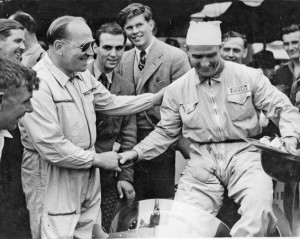 """Reg Parnell, left, with another early member of the Grand Prix Drivers Club, """"Nino"""" Farinaa whilst future member, Tim Parnell, stands tall in the background."""