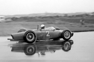 Phil Hill in the wet at Aintree with his world championship winning Ferrari at the 1961 British Grand Prix
