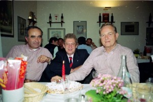 Phil Hill, right, with Jean Sage, left and Graham Gauld in the San Donnino restaurant with the birthday candle. (Photo Jane Wallis-Hosken)