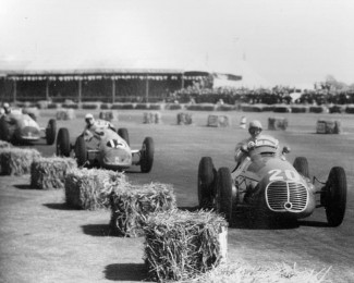"""Toulo"" in Enrico Plate's Maserati 4CLT/48 leads Louis Rosier and Philippe Etancelin in their Talbot-Lago's in the 1950 British Grand Prix at Silverstone. (Photo Ferret)"