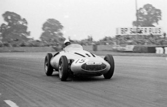 Manzon at the wheel of the streamlined Gordini grand prix car that ran in the 1956 season.