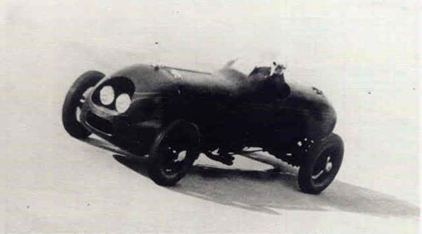 The streamlined Hotchkiss competing at Brooklands. The bodywork had been cleaned up after the record attempts at Montlhery where a further two headlights had been added