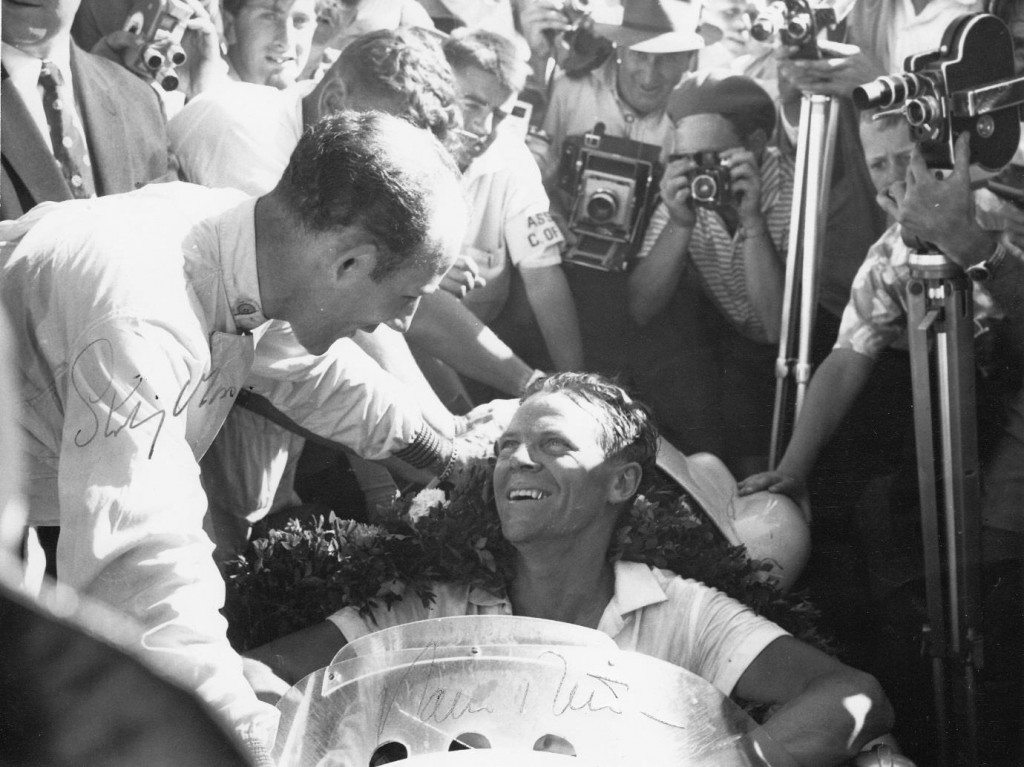 Paul Frere is congratulated by Stirling Moss in winning the South African Grand Prix in 1960 in a Cooper. It was a Formula Libre event