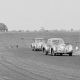 Ken Downing in his Healey Elliot saloon being chased by Harry Havelock-Slack's shooting-brake version at Charterhall in 1952.