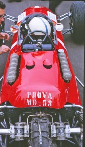 Ferrari chief engineer Mauro Forghieri, left with John and the classic flat 12 Ferrari grand prix car.