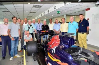 GPDC members with the latest Toro Rosso grand prix car in the factory. Left to right, Claude Le Guezec, Emanuele Pirro, Club Secretary Theo Huschek, Jo Ramirez, Tim Schenken, Hans Herrmann, Howden Ganley, Franz Tost Principal Toro Rosso, Teddy Pilette, Mario Theissen, Graham Gauld, Antoine Seyler, Reine Wisell and Dr Gerald Brandstetter. (Photo Peter Meirhoffer)