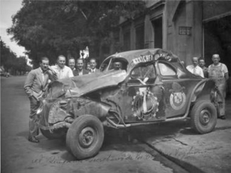 Benedicto Campos, extreme left with his wrecked Dodge after a roll-over