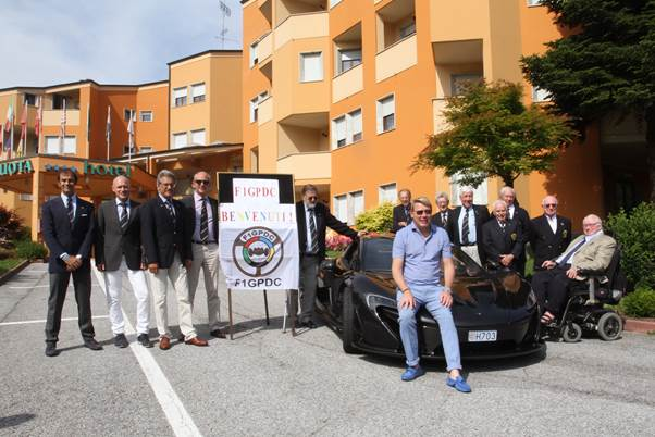 Some of the Grand Prix Drivers Club members gather round Mika Hakkinen's McLaren for a family picture. On the extreme right is Guy Edwards who had come all the way from Ireland for the meeting.( Photo Axel Schmitt.)