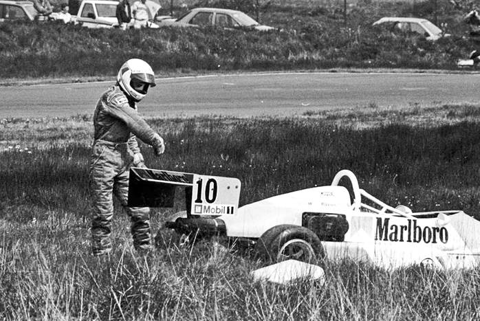 Mika Hakkinen throws his glove in frustration at his Formula Vauxhall Lotus after going off the road at Knockhill in 1988