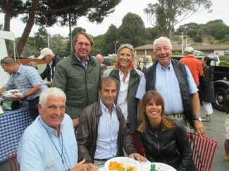 Yves Morizot, Emanuele Pirro and Marlene Pirro sitting and John Hugenholtz and his wife with Howden Ganley in Monterey