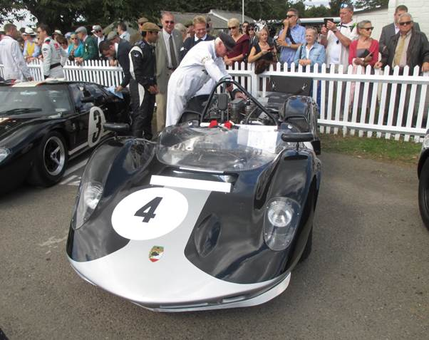 Karun Chandhok, on the left, rear, took time out from commentating to race this McLaren Mk 1A at Goodwood but suffered from mechanical problems (Photo Ganley)