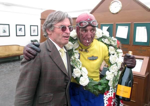 "Alain de Cadenet with ""Tazio Nuvolari"" at the Rolex drivers room at Goodwood. <em>(Photo Ganley)</em>"
