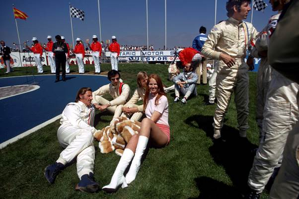 Can you imagine this at a grand prix today?  GPDC members Graham Hill, Tim Schenken, Henri Pescarolo and Howden Ganley relaxing with Ronnie Peterson and friend. (Photo Peter Nygaard: Grand Prix Photo)
