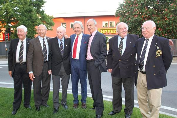 John Surtees at his last meeting with the Grand Prix Drivers Club outside the Ferrari factory in Maranello in 2016. Left to right Howden Ganley, Jo Ramirez, John Surtees, Derek Bell, Tim Schenken, David Piper and Teddy Pilette. (Photo Axel Schmitt)