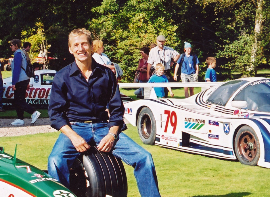 Johnny Bute, the Marquis of Bute, at the Classic event he organised on his estate on the Island of Bute in the early 1990s. Just visible behind him is the TWR Jaguar with which he won Le Mans.