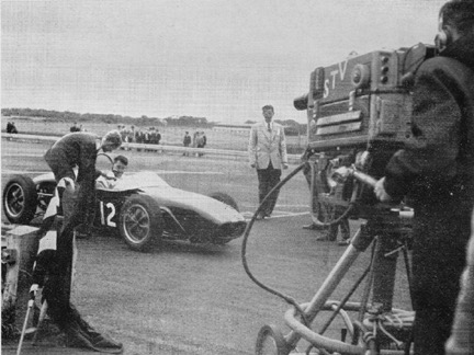 At the end of the race the writer interviews winner Peter Procter with his Lotus 19 in front of the STV cameras.