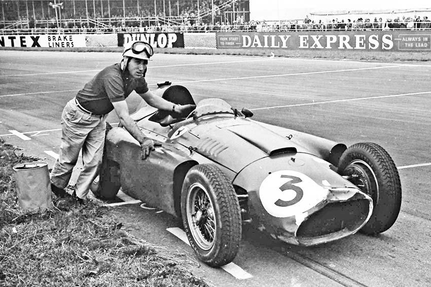 The Marquis de Portago pushes his Lancia-Ferrari across the line, British Grand Prix Silverstone 1956.