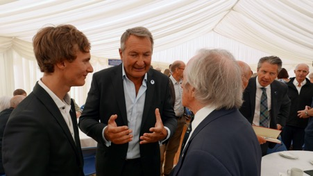 Ulysse, left, and his father Emmanuel Delsaux discussing Aspergers Syndrome with Sir Jackie Stewart.